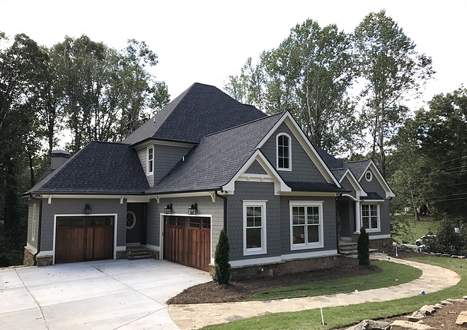 Gorgeous roof lines, transoms and round windows combine you give you a Traditional house plan with terrific curb appeal