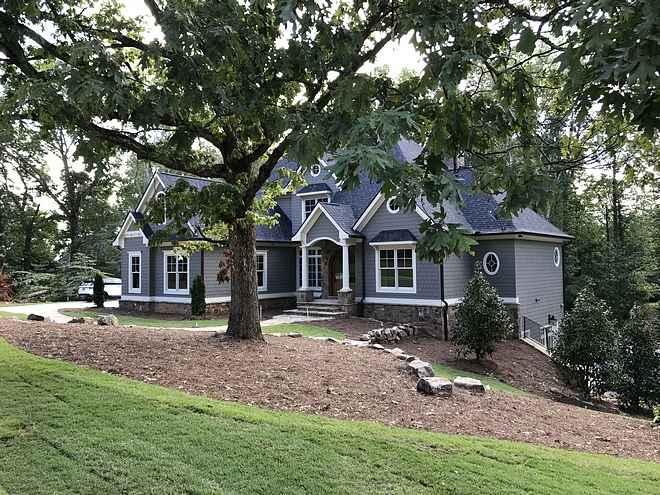 This newly-built home features gorgeous roof lines, transoms and round windows #home #newlybuilthome #curbappeal