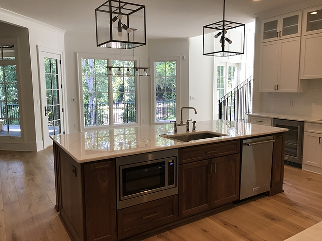 Kitchen Island Appliance The dishwasher and a built-in microwave were placed in the island, flanking the main sink #Kitchen Island Appliances Kitchen Island Appliance #KitchenIsland #kitchenAppliances