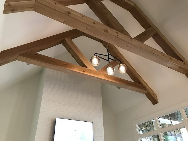 Exposed trusses ceiling with modern chandelier exposed trusses ceiling #exposedtrusses #trussesceiling