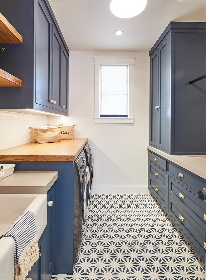 Navy Laundry Room Cabinets painted in Dunn-Edwards DE5824 Outer Space and flooring covered in navy and white cement tile Navy Laundry Room Navy Cabinet #navylaundryroom #laundryroom #cabinets #DunnEdwardsDE5824OuterSpace
