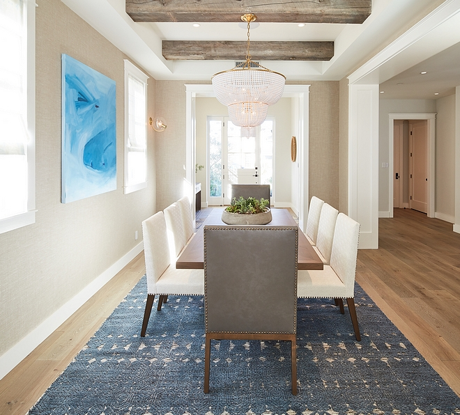 Neutral Farmhouse Dining Room with Ceiling Beam Dining room feels neutral, casual but tailored at the same time Walls feature a Holland and Sherry wallpaper #diningroom #neutraldiningroom #farmhosuediningroom