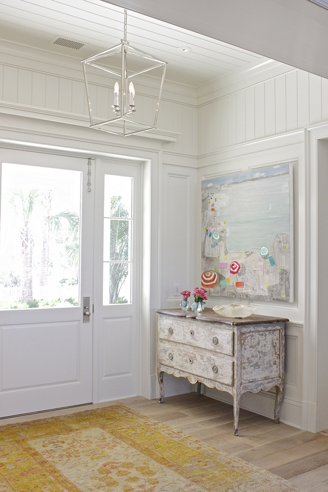 Benjamin Moore White Dove Foyer cWalls and ceiling feature a combination of traditional wainscoting and tongue and groove paneling #BenjaminMooreWhiteDove #traditionalwainscoting #paintcolor #tongueandgroove