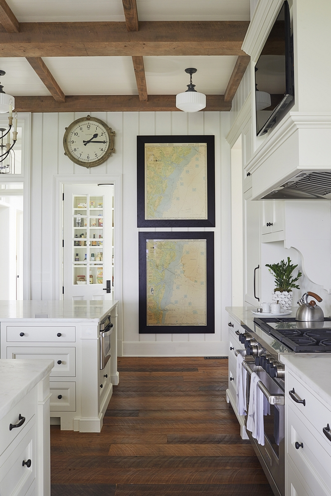 Kitchen Hardwood Flooring Wide-plank, reclaimed heart pine flooring carries throughout the home with occasional brick flooring in ancillary spaces #KitchenHardwoodFlooring #Kitchen #HardwoodFlooring #Wideplankflooring #reclaimedhardwoodflooring #heartpineflooring