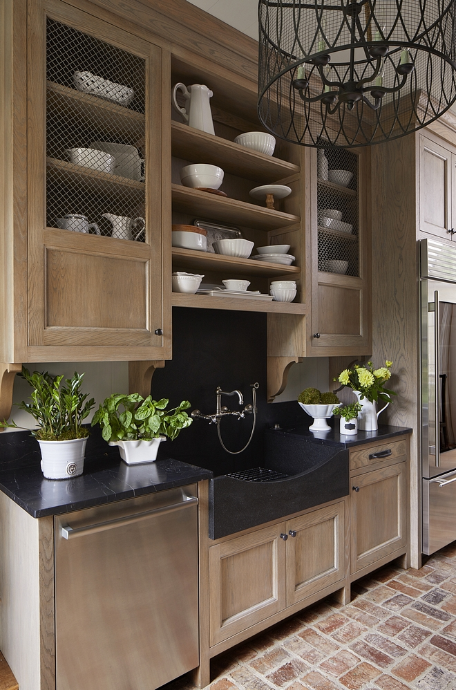 Butlers Pantry The butler's pantry features Rift Oak cabinet, Soapstone countertop, Soapstone slab backsplash and a custom natural stone farmhouse sink, also made of Soapstone Flooring is reclaimed brick Brick laid in a basket weave pattern #butlerspantry #RiftOakcabinet #Soapstone #countertop #slabbacksplash #stonefarmhousesink #brickFlooring #reclaimedbrick
