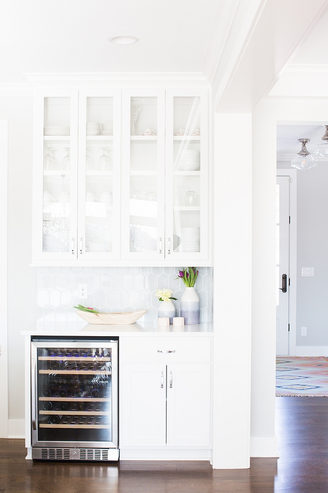 Kitchne bar The kitchen also features a bar cabinet with under-counter beverage fridge #kitchenbar #beveragefridge #bar #barcabinet