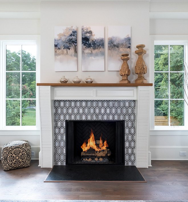 Fireplace Geometric Tile The focal point of this space is the gas log fireplace with designer tile surround #Fireplace #GeometricTile