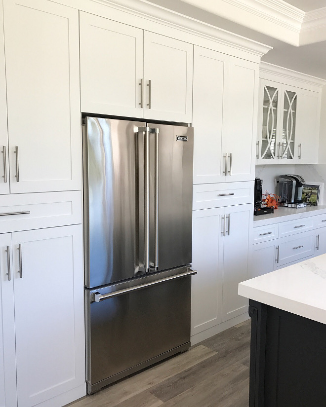 "Shaker style kitchen cabinet surrounding a Viking fridge with French doors The cabinets are custom-made in ""white"" shaker style with modern hardware#shakercabinets #shakerkitchencabinet #kitchen #Vikingfridge #frenchdoorsfridge"