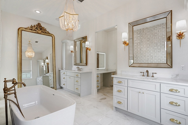 Master Bathroom The master bathroom is truly breathtaking Grey vanities are complemented with brass hardware and marble tiling adds a traditional and timeless feel to the space #masterbathroom #greyvanities