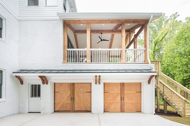 We balanced the all white exterior with beautiful cedar accents. In the back of the home we let the natural cedar steal the show on the beams and garage doors by using a clear coat only