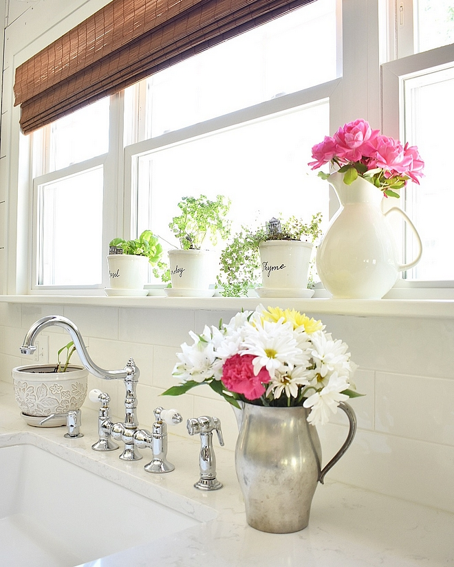 White kitchne with classic white subway tile and marble looking quartz countertop Affordable and timeless kitchen #Whitekitchne #classicwhitesubwaytile #whitesubwaytile #quartz #countertop