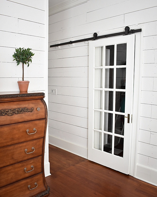 I reused every single original door that was found in the cottage  For my master closet and master bath, I repurposed two of the original French doors that led into the dining area  By placing them on barn door tracks, I was able to save space in these areas