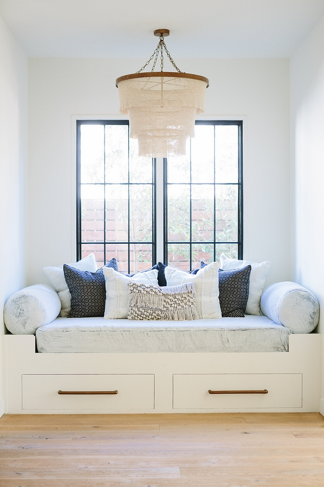 Custom window seat reading nook with black steel windows, Pehuen Pillows and made goods patricia chandelier natural #windowseat #blacksteelwindows #blackwindows #pillows