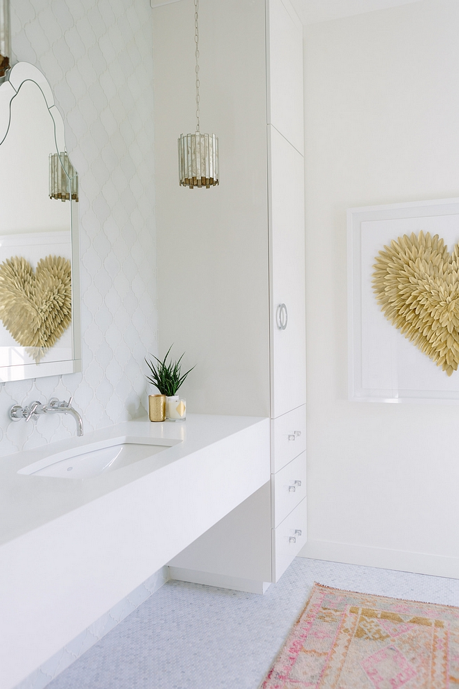 Bathroom Delicate and timeless choices bring a timeless yet current feel to this bathroom. Vanity is wrapped in a white quartz #Bathroom #whitequartz
