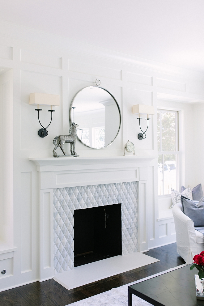 Wood burning fireplace using trim to create window seats on either side and a really fun tile around the surround #fireplace #woodburnfireplace