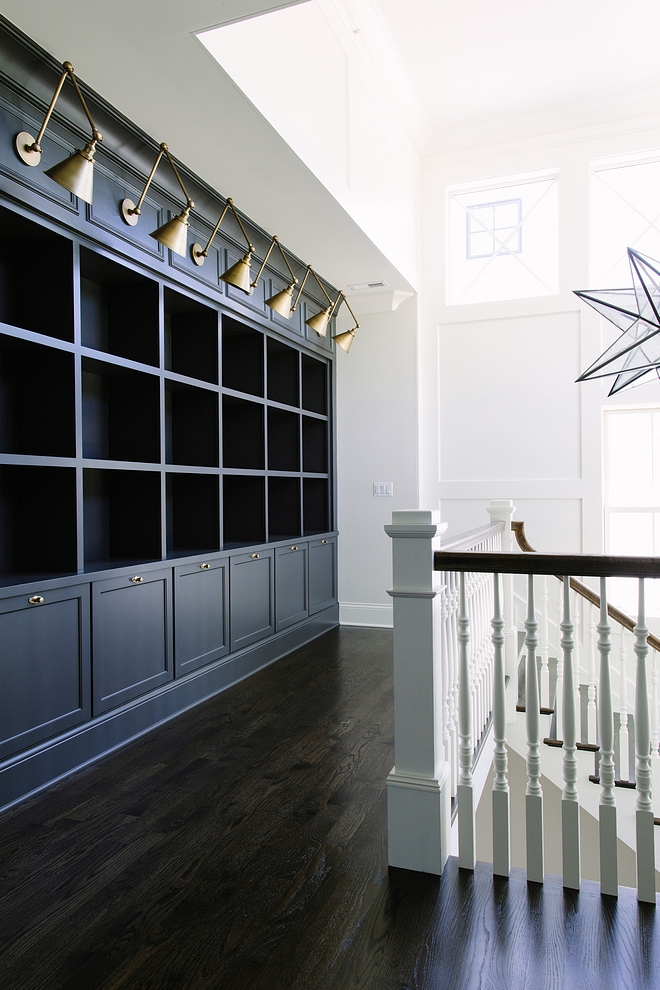 Benjamin Moore Iron Mountain The second floor features a 14' built-in cabinetry and bookcase with library lighting #BenjaminMooreIronMountainr #BenjaminMoorepaintcolor