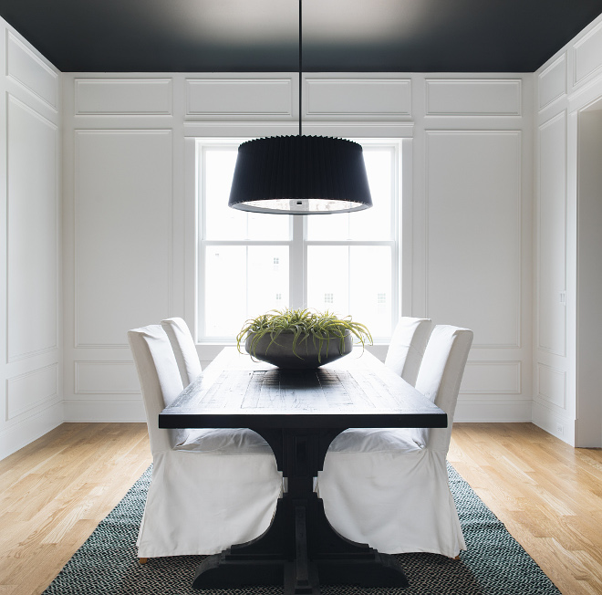 Dining room with white paneling wall painted in Benjamin Moore Simply White Ceiling paint color is Benjamin Moore Black #diningroom #paneling #paintcolor #BenjaminMooreSimplyWhite