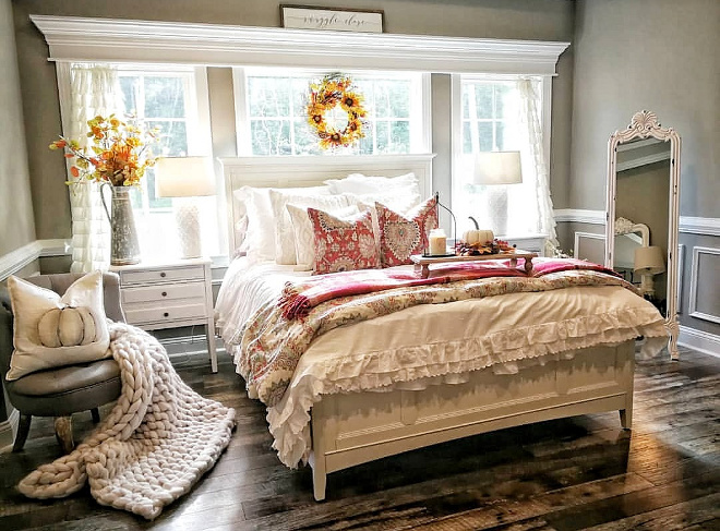Farmhouse Bedroom Fall decorating is so easy. I use a plain white comforter and add color by folding blankets at the foot of the bed and seasonal pillows. I love a bedroom filled with natural light
