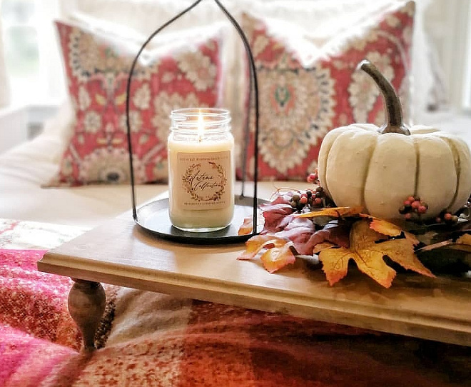 Handmade candles As you can see the candle pillars are keeping the leaves from falling off. Fall blankets and lots of baskets create a warm cozy fall feeling
