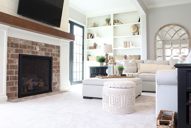 Living Room with brick and shiplap fireplace Mantle is stained to match countertop which is the Country Pine #brickandshiplapfireplace #fireplace #livingroom