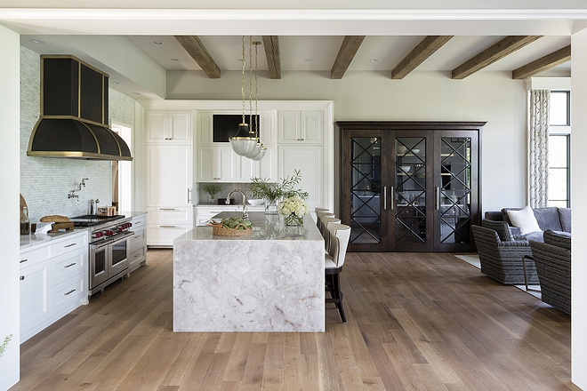 Kitchen A Custom Walnut and Glass door leads to butlers pantry and conceals the kitchen bar #kitchen #butlerpantry #kitchenbar #walnut