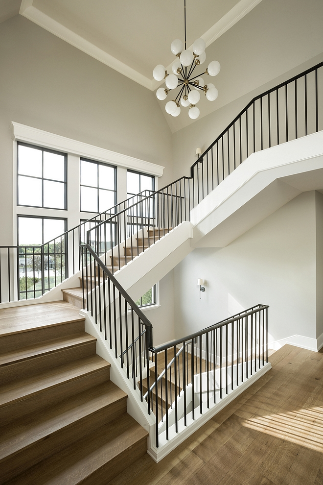 Benjamin Moore Collingwood Staircase with White Oak threads and risers with metal railing and walls painted in Benjamin Moore Collingwood #BenjaminMooreCollingwood