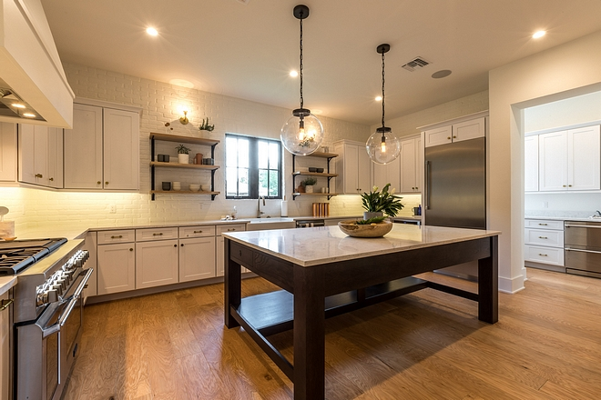 White Kitchen New White Kitchen design This white kitchen features shaker-style cabinets, a large Oak island and a great layout. Notice the butler's pantry on the right #whitekitchen #newwhitekitchen #newwhitekitchendesign