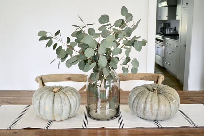 A simple centerpiece of fresh eucalyptus and heirloom pumpkins set the tone for our informal dining space
