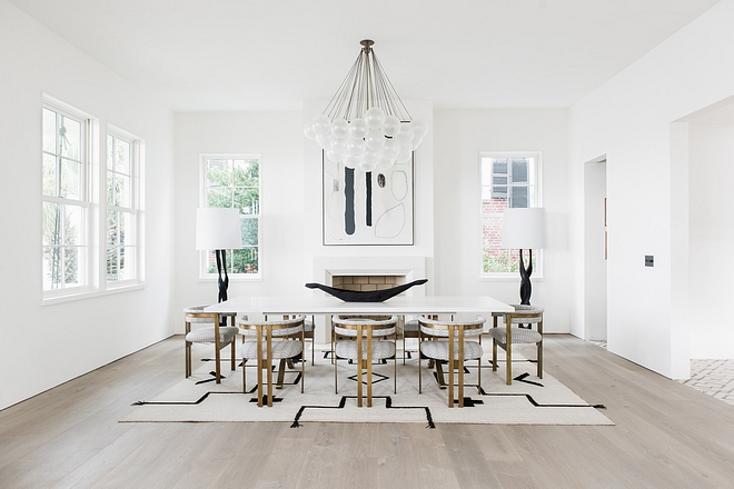 Modern Dining Room The room occupies both dining and entertaining areas - the ideal gathering space for a family that loves to host #ModernDiningRoom