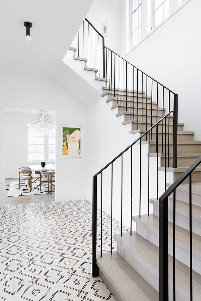 Foyer with White Oak Staircase, Metal Railing and Navajo Zebra Cement Tile #Foyer #WhiteOak #Staircase #MetalRailing #NavajoZebraCementTile #CementTile