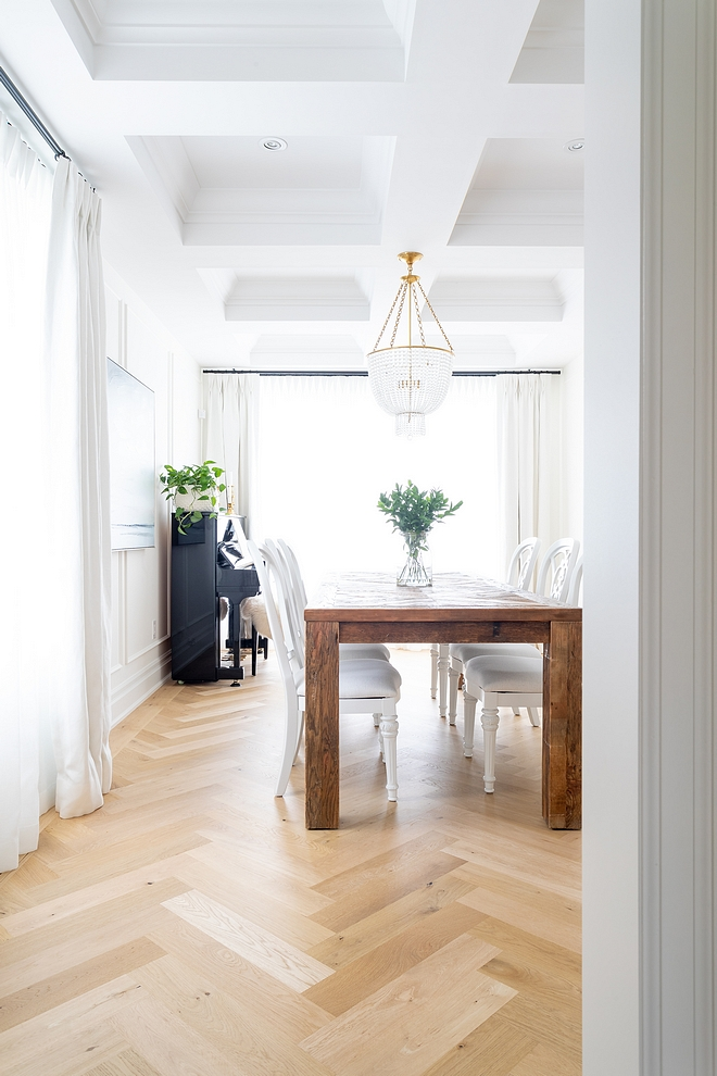These herringbone floors were a last minute decision which turned out to be our favourite feature of this room We also added some millwork to give the white walls some interest #HerringboneHardwoodFlooring #herringboneflooring