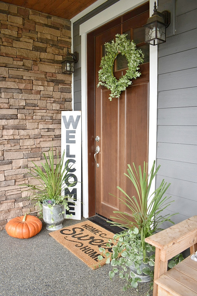 Fall Decor We actually had these same flower pots flanking our front door this summer, but to add a fall touch I added a small cabbage plant into the pot as well