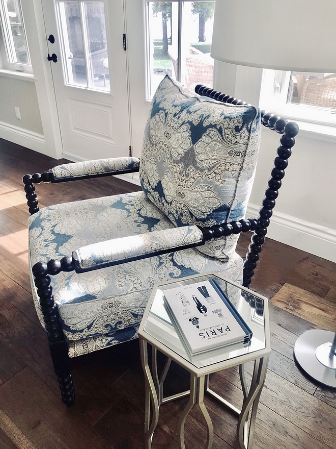 Spindle chair upholstered with blue and white Robert Allen fabric