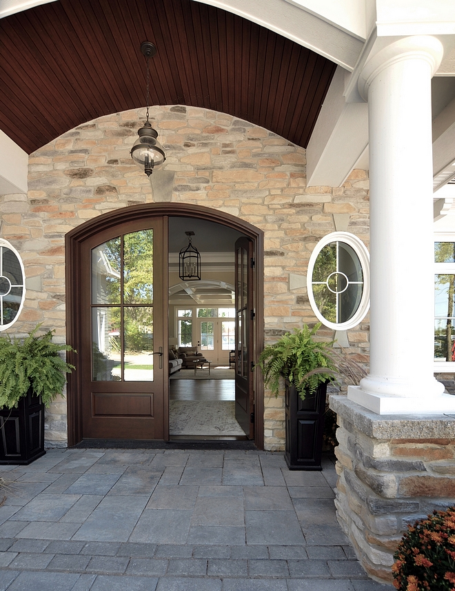 Arched Front Door Front Entry with plank ceiling stone wall Double front doors arched Porch ceiling #archedentry #porch #archedfrontdoor #plankceiling #porchceiling #frontdoor #archeddoor #doubledoors