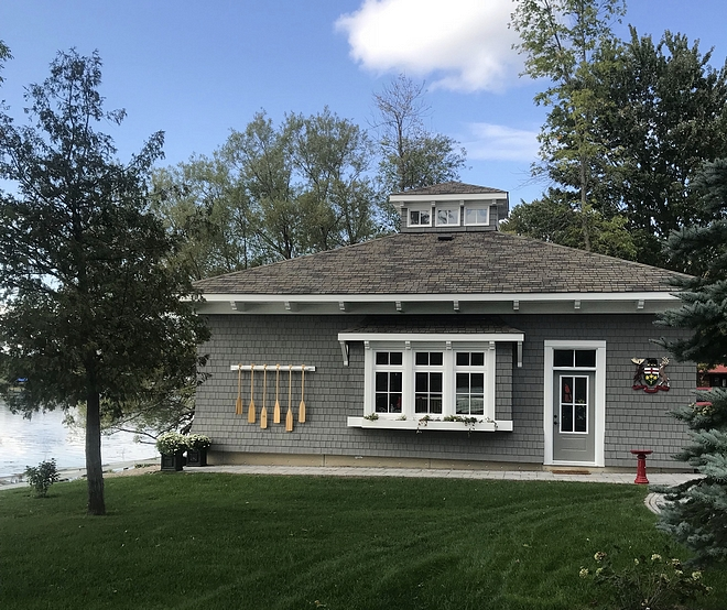 Boathouse Our boathouse is home to all of our lake toys, while complimenting the architectural design of the main house #boathouse