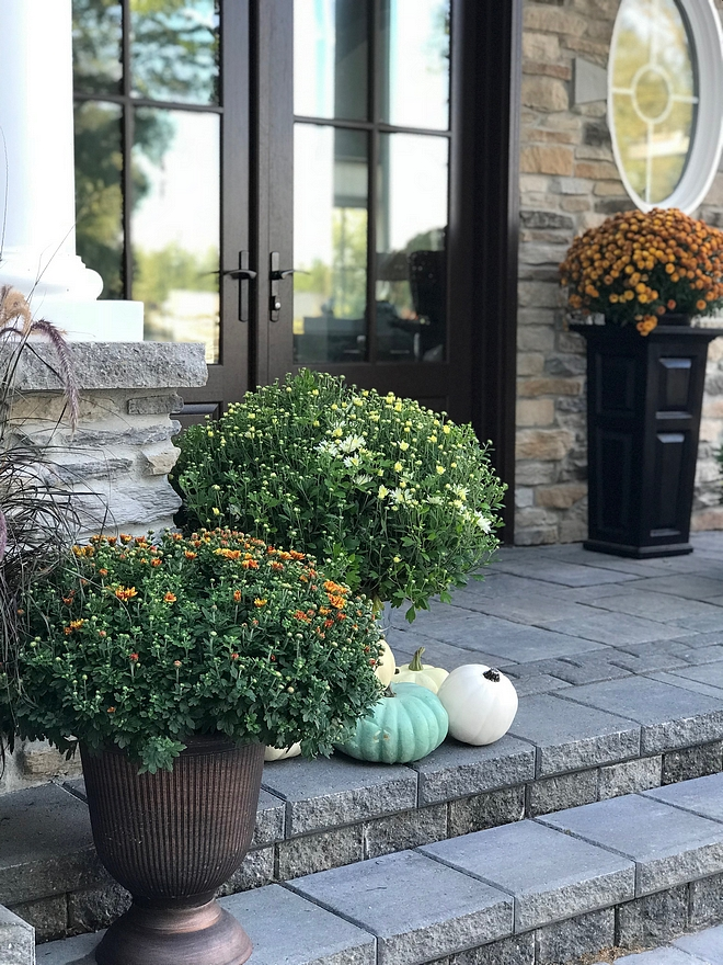 Fall Porch I've always found decorating for fall fun although I like to keep decor simple. I add some colourful mums from our local nursery that compliment the exterior colour of the stone, and add pumpkins from Michael #Fall #porch #mums