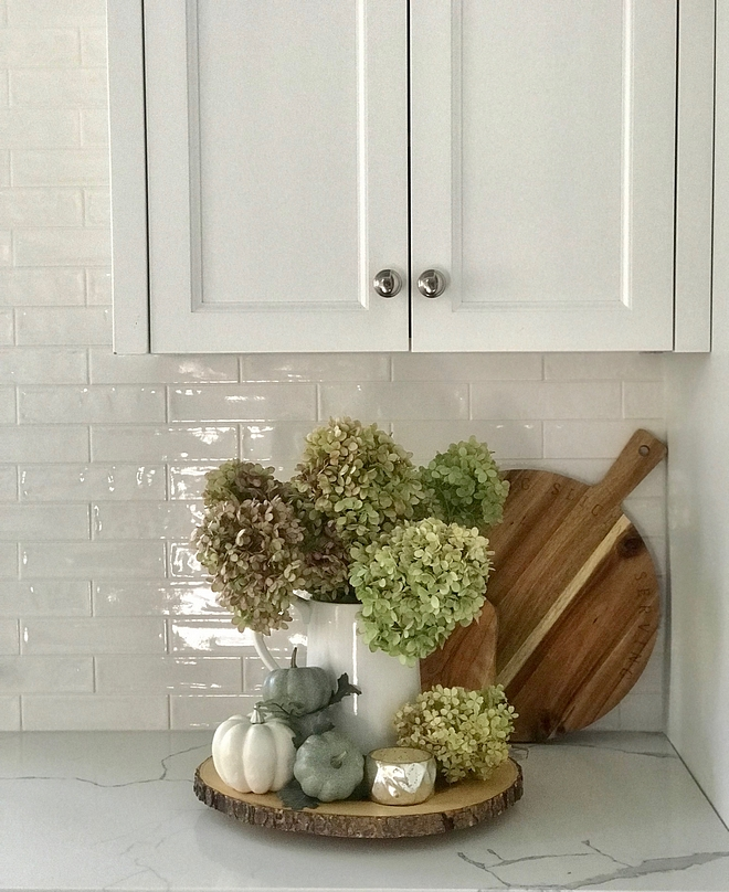 I welcome fall into our home by clipping large bunches of Limelight hydrangeas from the garden and filling up various vases. You'll find a vase filled with hydrangeas in almost every room of our home #kitchen #Fall #kitchenfall #hydrangeas