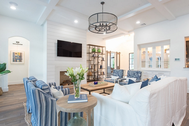 The foyer opens to a beautifully designed living room with coffered ceiling and shiplap fireplace #livingroom #cofferedceiling #shiplapfireplace