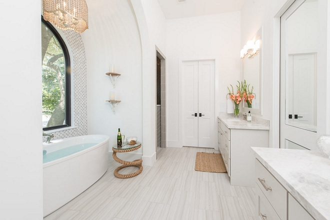 The master bathroom has a very European-chic feel I also like the idea of having the shower tucked away from the main space