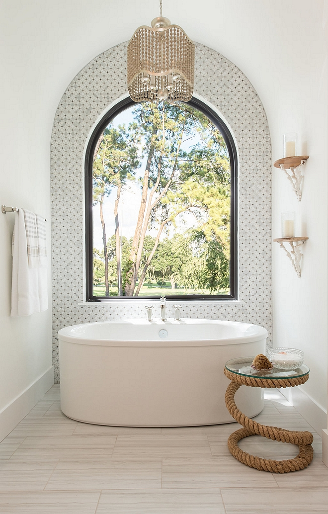 Arched Bath Nook Arched Bath Nook with marble mosaic accent tile, freestanding tub, arched window and beaded chandelier Arched Bath Nook #ArchedBathNook #ArchedNook #BathNook