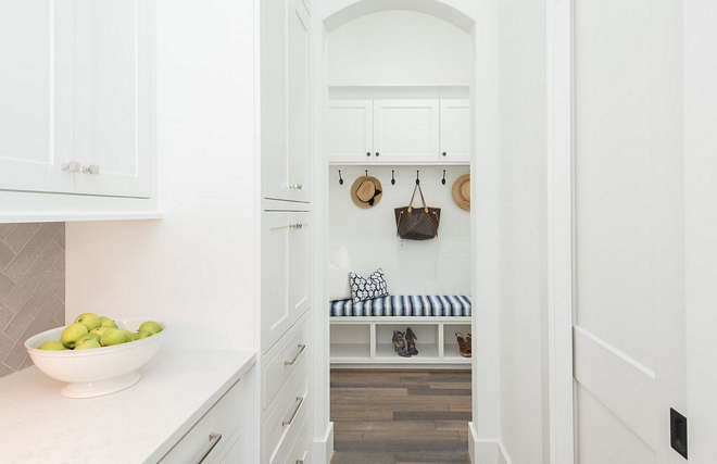 A mudroom is located just off the kitchen area. Notice the pantry door on the right #mudroom #pantry #pantrydoor