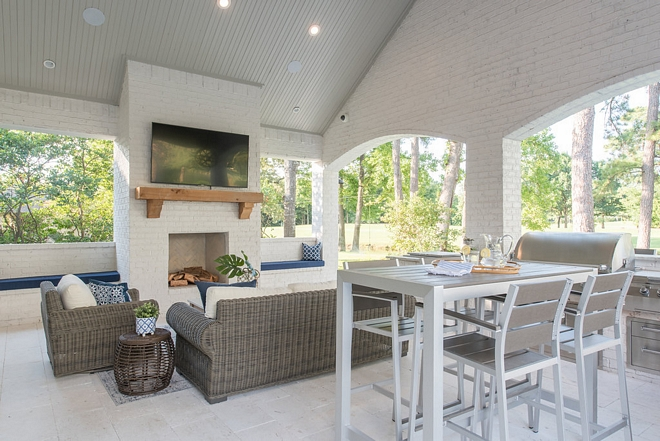 The outdoor brick fireplace is painted in Sherwin Williams Toque White