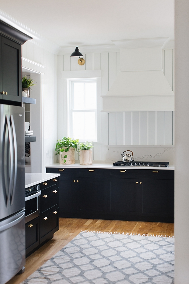 Shaker-style kitchen cabinet painted in BM Black with vertical white shiplap as backsplash Shaker-style kitchen cabinet Black Shaker-style kitchen cabinet #Shakerstylekitchencabinet #Shakerstylecabinet #Shakercabinet