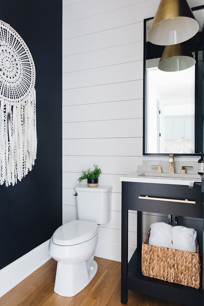 Black and white bathroom The powder room features shiplap and a custom designed vanity painted in Benjamin Moore Black #blackandwhite #bathroom #benjaminmoore #shiplap