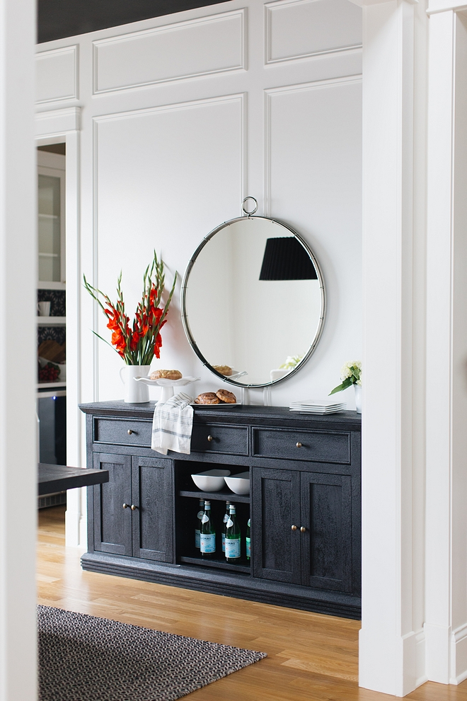 The designer added extensive millwork to the dining room by using panel molding and then painted the whole room in Benjamin Moore's Simply White - semi gloss #BenjaminMooreSimplyWhite