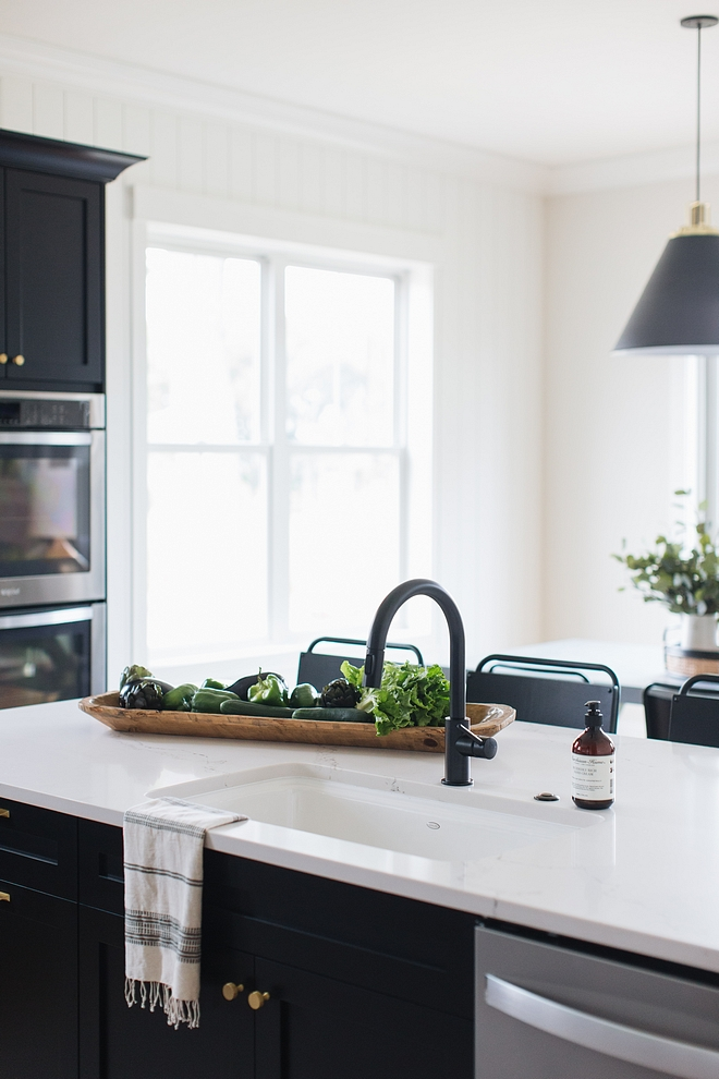 Matte Black kitchen Faucet with white sink and marble-looking quartz countertop over black kitchen cabinets #blackkitchen #blackkitchencabinets #matteblack #MatteBlackkitchenFaucet #MatteBlackFaucet