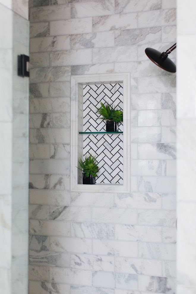 Shower niche A black and white herringbone mosaic tile beautifully accentuates the shower niche Shower niche tile #showerniche #showernichetile #showertile