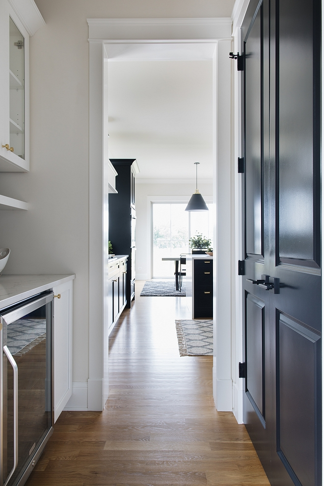 Black interior doors Black pantry door painted in Benjamin Moore Black #blackdoors #blackinteriordoor #blackBenjaminMoore #BenjaminMooreBlack