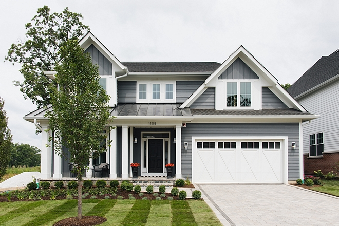 Grey Modern Farmhouse We traded the traditional white and black farmhouse for a dark grey facade We love how it pops off the white trim Grey Modern Farmhouse #GreyModernFarmhouse #ModernFarmhouse