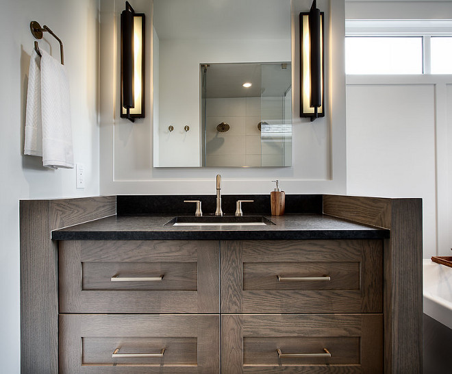 Bathroom Vanity Leathered Black granite countertop and large industrial sconces